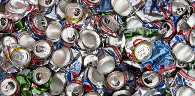 Large number of aluminium drinks cans for recycling.