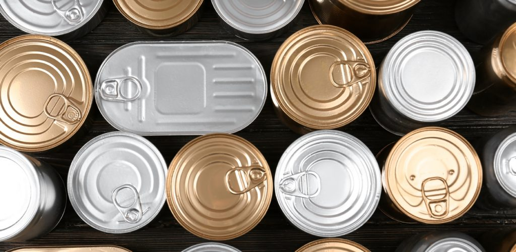 Many tin cans on wooden background, top view. Recycling garbage