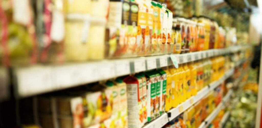 Image of shelves with different grocery products in the supermarket