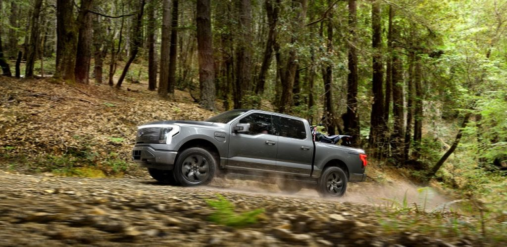 2022 Ford F-150 Lightning Lariat. Pre-production model with available features shown. Available starting spring 2022. Always consult the owner's manual before off-road driving, know your terrain and trail difficulty and use appropriate safety gear.