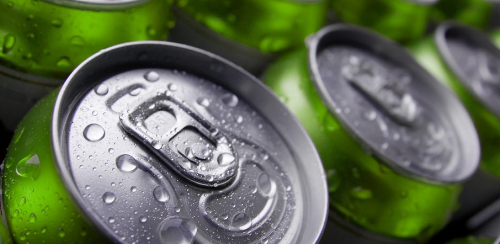 Many cans of cold beer with condensation water droplets
